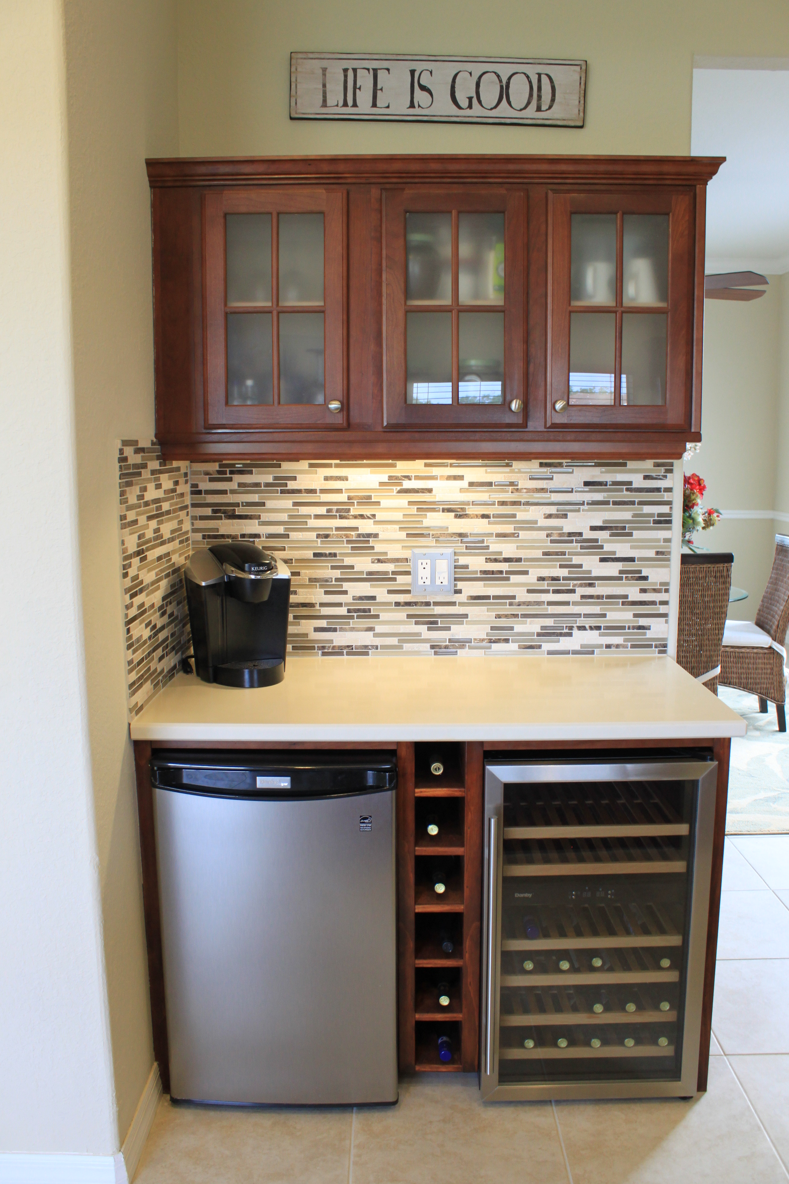 Custom Dry bar with tiled backsplash