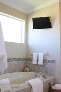 Tiled backsplash and wall mounted tv.