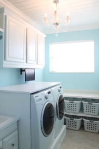 Custom laundry room cabinets, shelves, custom wood ceiling, wall mounted tv.